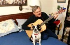Boston Terrier Singing With Owner